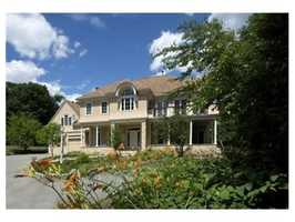 The 6,300 square foot Concord Avenue home includes an attached, 2-car garage.