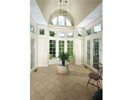 The foyer also features a solarium, water fountain and floor to ceiling windows.