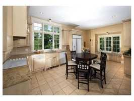 The open floor plan offers a large gourmet kitchen with high-end appliances.