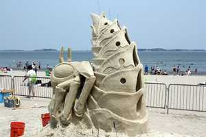 Bouchard travels the world as a professional, making sand sculptures for commercial events.