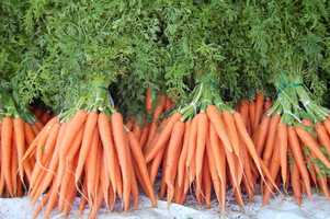 Being deficient in A can cause acne, dry hair, dry skin, and broken fingernails. Get your daily vitamin A fix by eating five baby carrots each day.