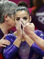 U.S. gymnast Alexandra Raisman reacts after qualifying for the women's all-around final during the Artistic Gymnastics women's qualification.