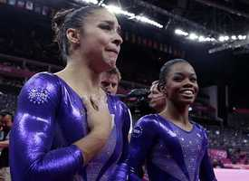 U.S. gymnast Alexandra Raisman, left, reacts after qualifying for the women's all-around final along with teammate Gabrielle Douglas during the Artistic Gymnastics women's qualification.