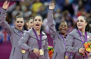 "U.S. gymnasts, left to right, McKayla Maroney, Kyla Ross, Alexandra Raisman, Gabrielle Douglas and Jordyn Wieber celebrate during the medal ceremony of the Artistic Gymnastics women's team final.  ""We knew we could do it,"" Raisman said. ""We just had to pull out all the stops."""
