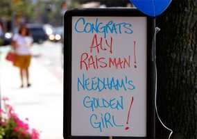 A sign outside Taylor's Accents Gifts shop recognizes gymnast Aly Raisman in her hometown of Needham.