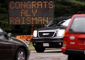 A construction sign on the corner of Dedham Avenue and South Street recognizes the accomplishments of gymnast Aly Raisman in her hometown of Needham.