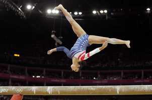 Alexandra Raisman performs on the balance beam during the artistic gymnastics women's apparatus finals.