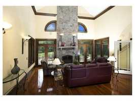 A family room includes one of three fireplaces found throughout the home.