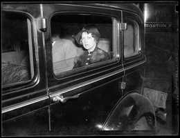 Courtesy of the Boston Public Library, Leslie Jones Collection, photos of crimes that made news in Boston in the 1930s.Here: Mrs. Grace Prior of Allston is held in slaying of George Frame in 1935.