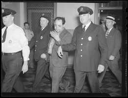 "William ""Fats"" Russo as he appeared in court after a shootout in the Bowdoin Square subway station in 1938"