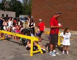 Aspiring gymnasts line up to see Raisman in Burlington.
