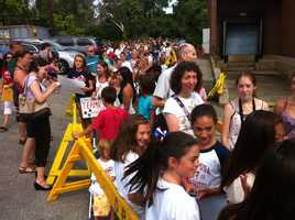 Young fans line up to meet Olympic superstar Aly Raisman in Burlington on Thursday.