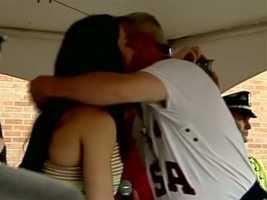 Aly's coach hugs the Olympian