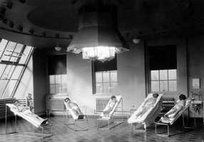 Sunlight was considered very important in the treatment of many diseases, especially rickets. Here, several children receive carbon arc and ultraviolet light treatments.