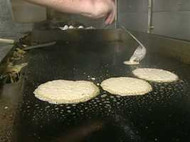 Johnny Cakes...once a colonial staple, remain a hot commodity here on the Farm Coast.