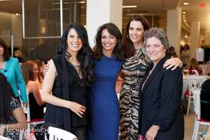 Linda Pizutti-Henry, Stacey Lucchino and Meg Vaillancourt of the Boston Red Sox join Liz in Sept. 2012 for a Boston Red Sox wives fashion show to raise funds for the Red Sox Foundation.