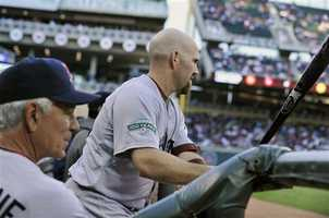 "Bobby Valentine, left, and Kevin Youkilis pictured together during a game against the Minnesota Twins on April 23. In mid April, Valentine issued his most public player criticism, saying he didn't think fan favorite Kevin Youkilis was ""as physically or emotionally into the game."" Youkilis demanded an explaination, and Valentine's comments promoted Dustin Pedroia to say ""That's not how we go about our stuff here."" Valentine later apologized to Youkilis."