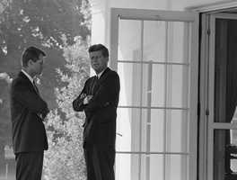 President John F. Kennedy, right, confers with his brother Attorney General Robert F. Kennedy at the White House in Washington, D.C., on Oct. 1, 1962 during the buildup of military tensions between the U.S. and the Soviet Union that became Cuban missile crisis later that month.