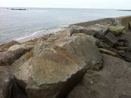 In Scituate, rocks were placed at a breach in the sea wall.