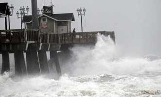 Large waves generated by Hurricane Sandy crash into Jeanette's Pier in Nags Head, N.C., Saturday, Oct. 27, 2012 as the storm moves up the east coast.