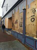 A hardware store in Hyannis is boarded up ahead of the storm