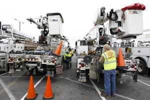 Utility workers get their gear ready at Glen Burnie, Md., facility as Hurricane Sandy approaches the Atlantic coast on Sunday, Oct. 28, 2012.