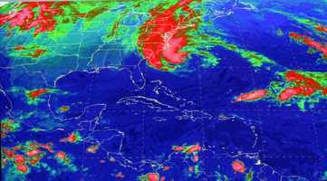 This satellite image from the National Hurricane Center in Miami shows Sandy, at 10:03 a.m., Sunday, Oct. 28, 2012.