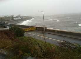 A portion ofWinthrop Parkway in Revere is gated early Monday morning as the storm moves closer.