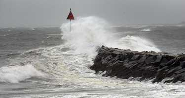 Waves crash along the shore in Marshfield Friday morning.