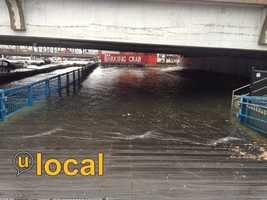 Flooding under the Seaport Street Bridge in Boston Monday afternoon.