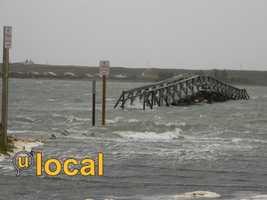 A flooded boardwalk in Sandwich Monday