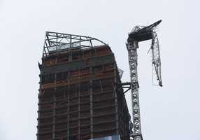 A construction crane atop a luxury high-rise dangles precariously over the streets after collapsing in high winds from Hurricane Sandy, Monday, Oct. 29, 2012, in New York.