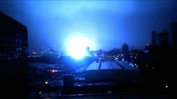 This image from video provided by Dani Hart shows what appears to be a transformer exploding in lower Manhattan as seen from a building rooftop from the Navy Yard in Brooklyn during Sandy's arrival in New York City. Much of New York was plunged into darkness Monday by a superstorm that overflowed the city's historic waterfront, flooded the financial district and subway tunnels and cut power to nearly a million people.