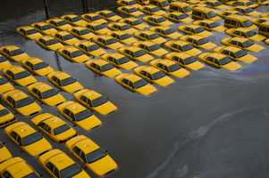 A parking lot full of yellow cabs is flooded as a result of Hurricane Sandy on Tuesday, Oct. 30, 2012 in Hoboken, NJ.