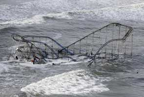 Waves wash over a roller coaster from a Seaside Heights, N.J. amusement park that fell in the Atlantic Ocean during superstorm Sandy on Wednesday, Oct. 31, 2012.