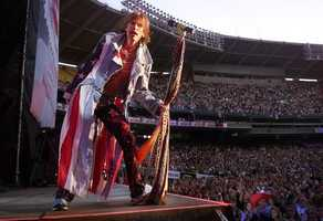 "Aerosmith lead singer Steven Tyler perform during the ""United We Stand: What More Can I Give?"" benefit concert Sunday, Oct. 21, 2001, at RFK Stadium in Washington. Tens of thousands of music fans gathered Sunday to see an array of pop stars at the marathon concert celebrating America and raising money for victims of September's terrorist attacks."