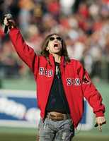 "Steven Tyler, lead singer in the rock band Aerosmith, leads the crowd at Fenway Park in Boston, in singing ""God Bless America"" during the seventh inning stretch of a baseball game against the Detroit Tigers, Tuesday, April 8, 2008. The Boston Red Sox shut out the Tigers 5-0."