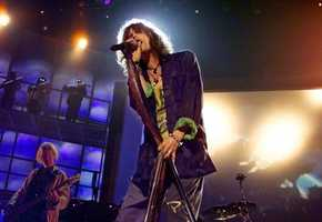 Aerosmith's Steven Tyler sings during the 1999 Grammy Awards rehearsal at the Shrine Auditorium in Los Angeles, Monday, Feb. 22, 1999.