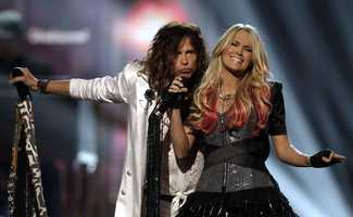 In this April 3, 2011 file photo, singers Steven Tyler and Carrie Underwood perform at the 46th Annual Academy of Country Music Awards in Las Vegas.