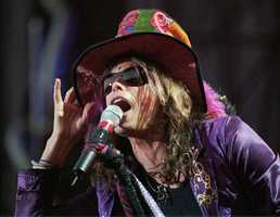 "Steven Tyler of Aerosmith performs in Old Orchard Beach, Maine, Monday, June 30, 1997. The concert was the group's first U.S. date of its ""Nine Lives"" tour."