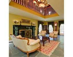 The flooring isWood, Tile, Marble, Stone / Slate