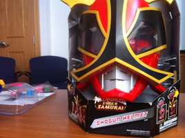 """Power Ranger Shogun HelmetAccording to W.A.T.C.H., there is the potential for impact and puncture wound injuries.The manufacturer encourages children to """"become a Power Ranger"""" by donning """"battle gear,"""" including this """"shogun helmet."""" The headgear includes an attachable """"crown"""" with pointed, rigid plastic tips as long as approximately 9"""" with the potential for penetrating impact and puncture wound injuries."""
