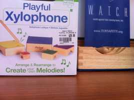 """Playful XylophoneAccording to W.A.T.C.H., there is the potential for choking injuries.Babies as young as twelve months old are encouraged to use a supplied slender, wooden dowel as a drumstick to play music on the xylophone. The approximately 5"""" drumstick, which is not connected to the xylophone, could be mouthed and occlude a child's airway"""