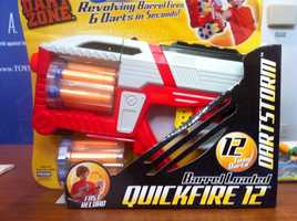 """Dart Zone Quickfire 12 Dart GunW.A.T.C.H. warns there is potential for eye injuries.The manufacturer of this dart gun with two """"revolving barrels"""" encourages children to load the ammunition cartridge and fire """"6 darts in seconds!"""" Despite the manufacturer's directive that this toy not be sold for children younger than 6 years old, it was marketed online for babies as young as 7 months old. The gun can shoot the supplied darts with enough force to potentially cause eye injuries."""