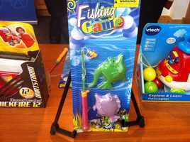 """Magnetic Fishing Game byKole Imports.POTENTIAL FOR CHOKING INJURIES! According to W.A.T.C.H., this """"fishing game"""" is sold online for 16-month-old children, however, the packaging contains a warning of a choking hazard for children under 3 years old. The plastic fishing pole uses common twine to attach a small, magnetic lure. The brightly-colored plastic lure, whether detached or connected to the approximately 9""""-long cord, poses a serious potential choking hazard for oral-age children."""