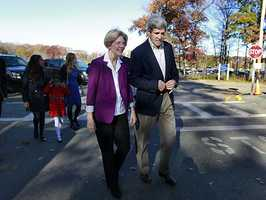 Democratic candidate for the U.S. Senate Elizabeth Warren, left, and U.S. Sen. John Kerry, D-Mass., right, walk and talk as they arrive at a campaign rally at a high school in Braintree, Mass., Sunday, Nov. 4, 2012.