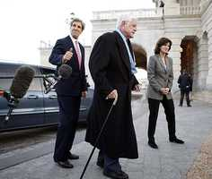 Sen. Edward M. Kennedy, D-Mass., center, with Sen. John Jerry, D-Mass., left, and his wife Victoria Reggie Kennedy, walks away after speaking with the media before the cloture vote on the Stimulus Bill on Capitol Hill in Washington, Monday, Feb. 9, 2009. Sen. Kennedy who was battling a brain tumor made his first his appearance since having a seizure in Statuary Hall at the Capitol.