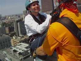 Liz Brunner rappels down 22 stories of the Hyatt Regency hotel to benefit Massachusetts Special Olympics.