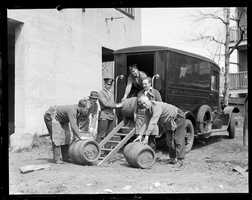 Police from Division 9 with casks seized during Prohibition, approx. 1930
