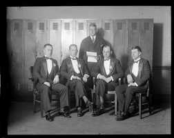 Boston Police Liquor Squad led by Oliver Garrett (second from right) dressed up in evening clothes for visits to Boston hotels on New Year's Eve in 1928